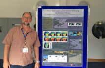 "Technical Team Lead Richard Davis stands in front of his poster titled ""Ocean Observations on the Scotian Shelf using Autonomous Vehicles,"" which he presented at the 7th EGO conference in Southampton, UK"